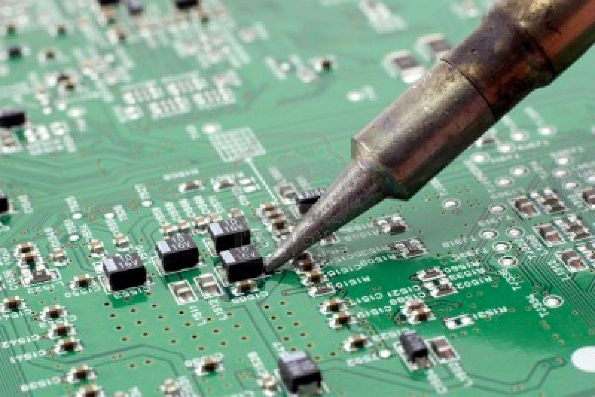 2047119-technician-repairing-electronic-circuit-board-with-soldering-iron-1